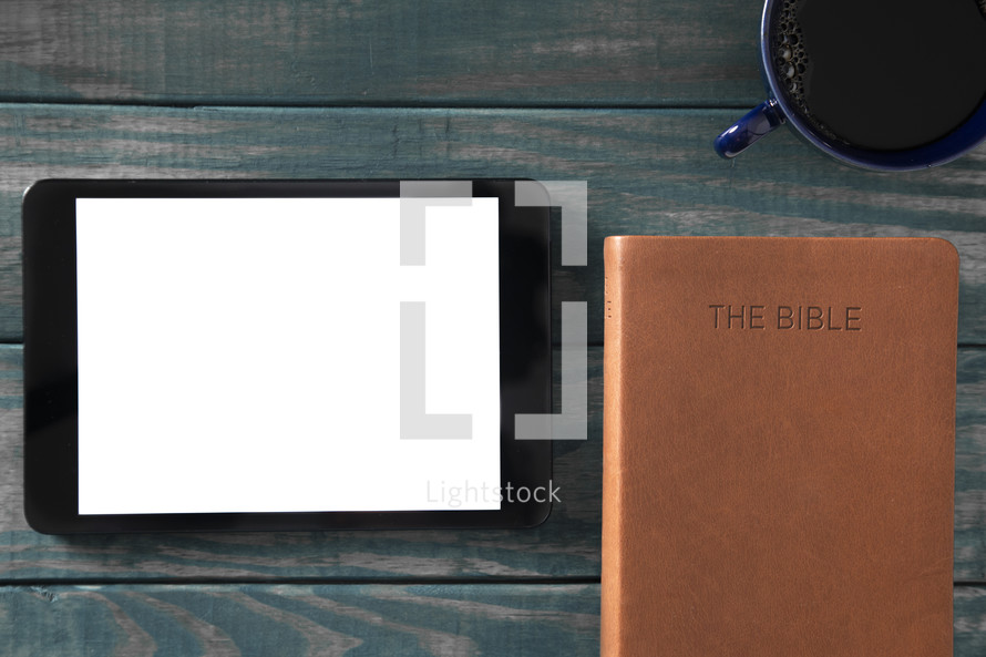 tablet, Bible, and coffee cup