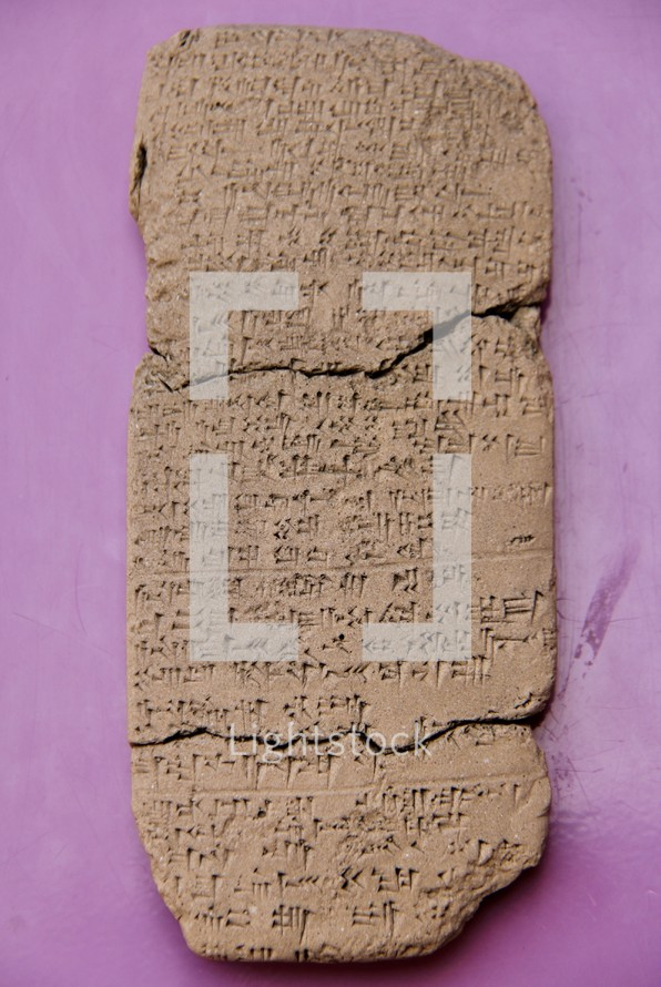 Ancient Cuneiform Writing on a Clay Tablet