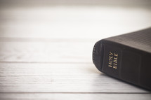 Holy Bible on white wood background