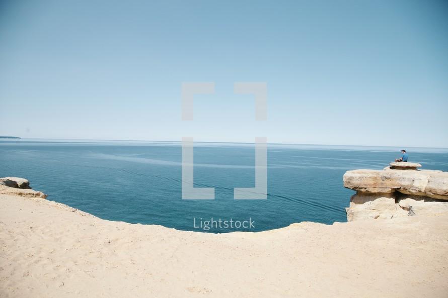 sea cliffs and sand along a coastline