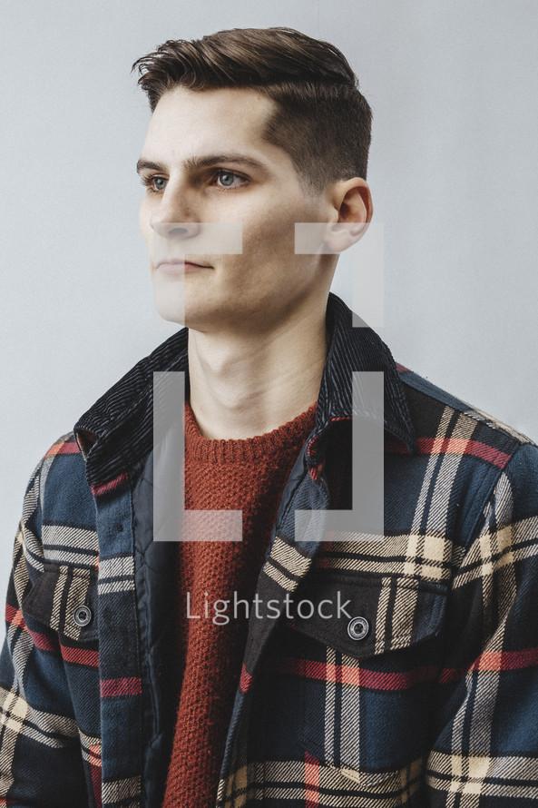 man in a plaid coat