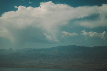 clouds over mountains and lake