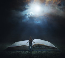 woman standing in front of a Giant Bible