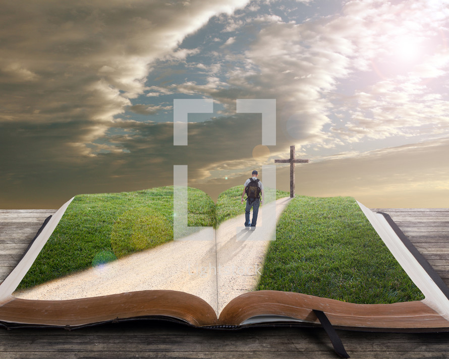 man on a spiritual journey walking down a road towards a cross standing on a Bible