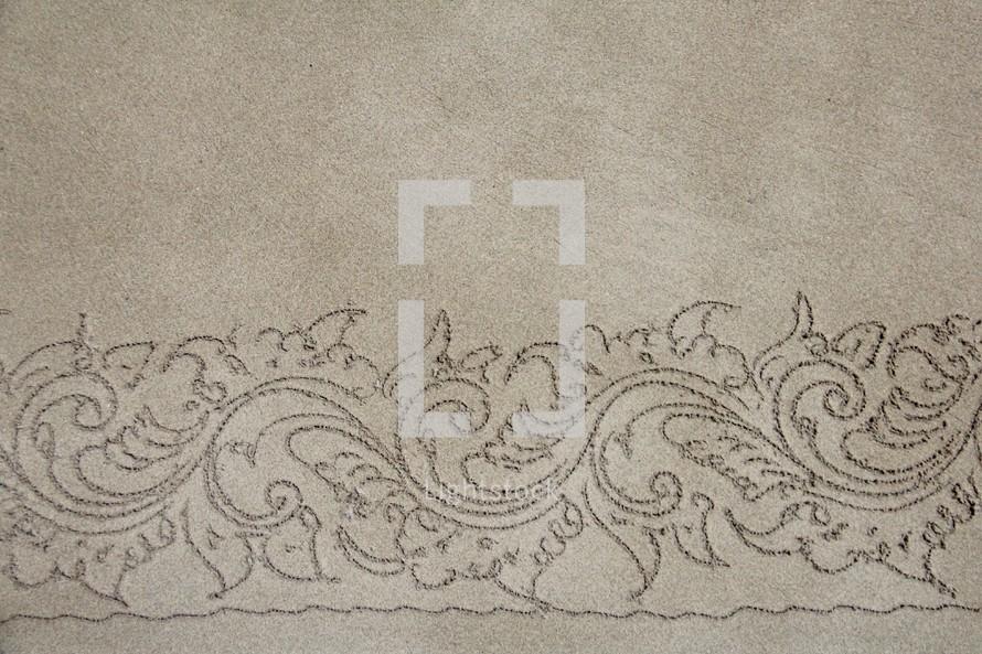 pattern border on a sandy beach