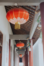 Chinese lanterns hanging from a ceiling