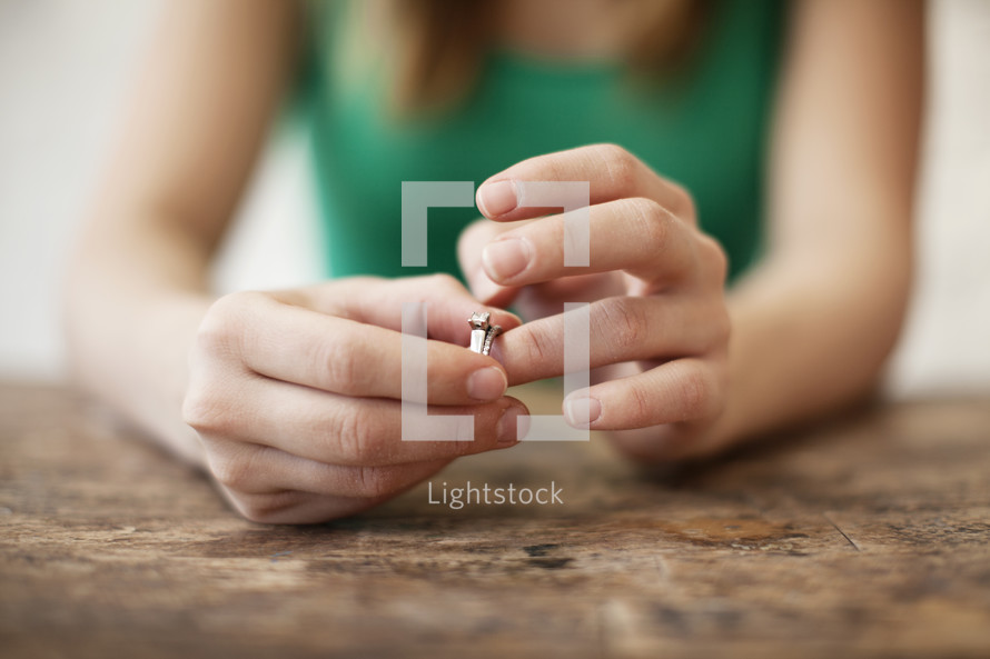 Woman playing with a wedding ring on her finger.