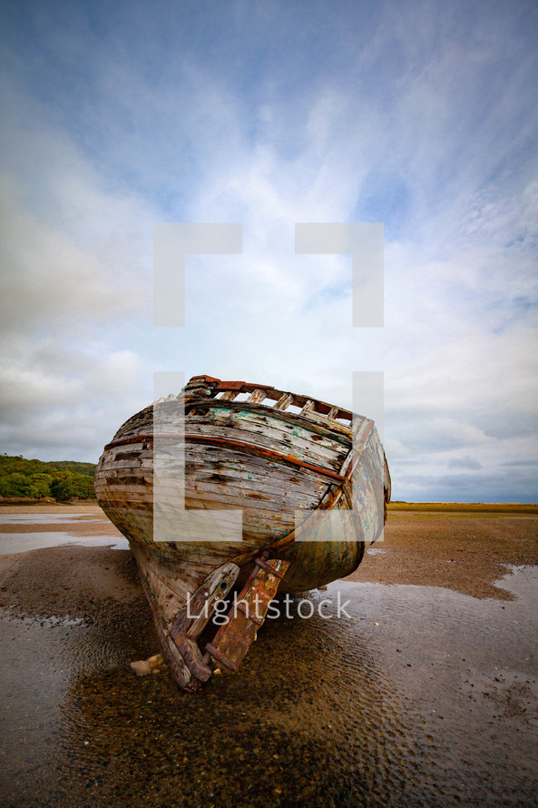 old beached boat on sand