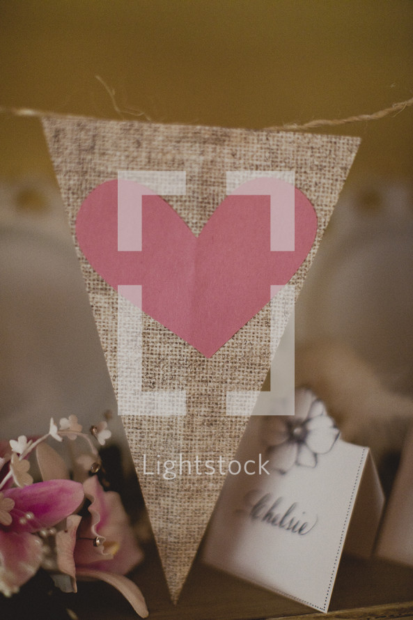 A pink heart cut out of construction paper