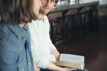 Two men reading discussing the Bible at a Bible study