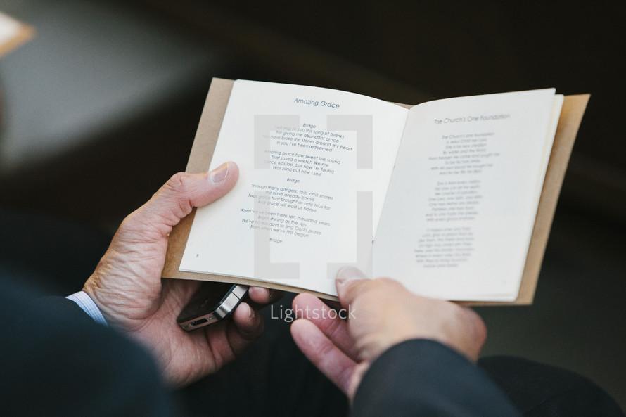 a hymnal open to Amazing Grace lyrics