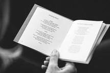hymnal opened to Amazing Grace lyrics
