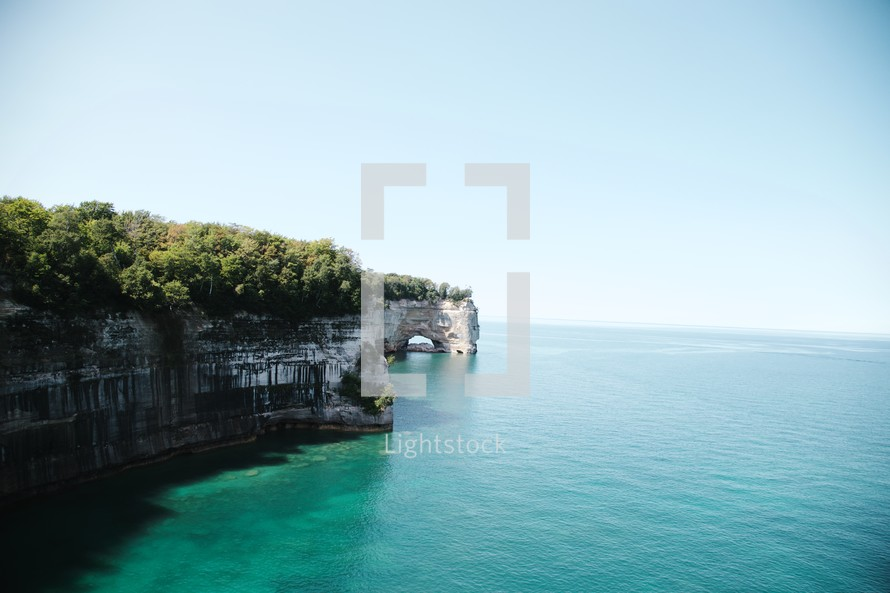 sea cliffs and sea cave along a shoreline