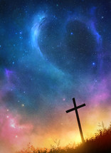 a cross under the night sky