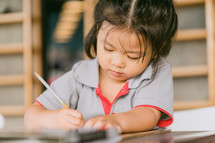a child erasing words on paper