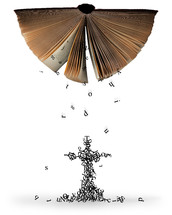Letters falling out of the pages of an upside down Bible to form a cross.