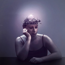 A woman lost in thought as her mind is filled with electric wires