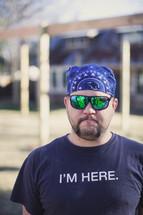 man wearing a bandana and shades