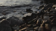 water lapping over rocks on a shore