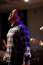 man singing at a worship service