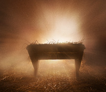 glowing light behind a manger