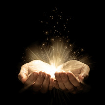 glowing twinkling light from cupped hands