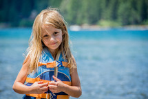 girl child wearing a life vest