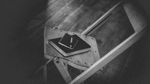 Bible and journal resting in a chair