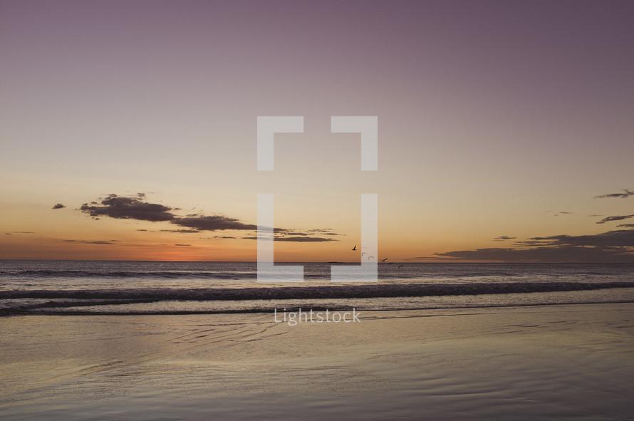 A sunset over a calm ocean