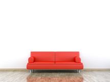 red sofa against a white wall