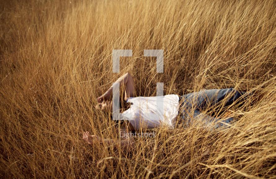 A woman lying in a field