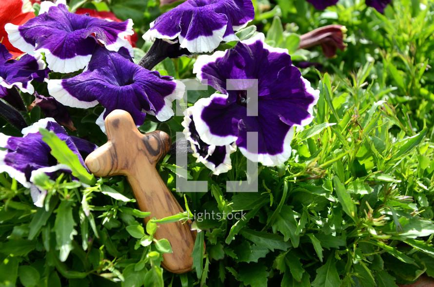 wood prayer cross on flowers