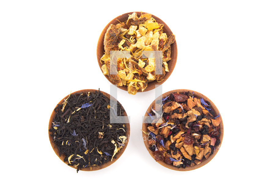 Loose Leaf Tea in a Wooden Bowl on a white background