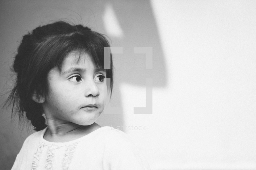 Head shot of a small girl, looking away