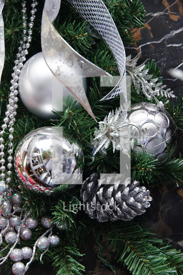 silver Christmas ornaments on a Christmas tree