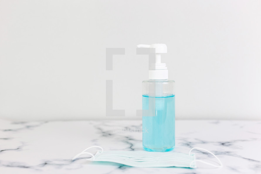 hand sanitizer and face mask