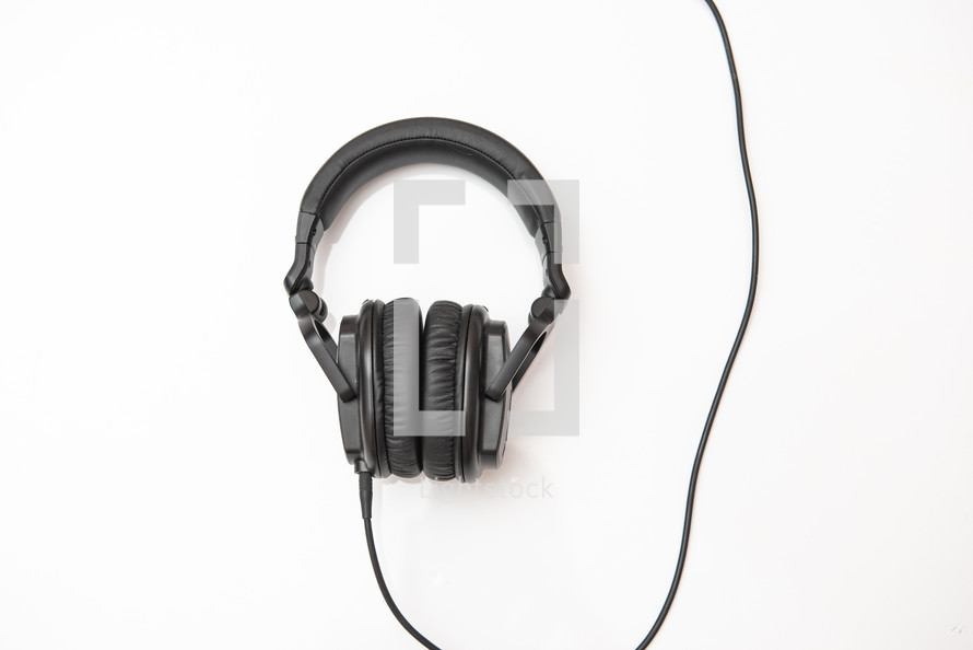 Black headphones on an isolated white background with copy space