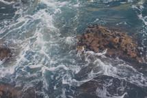 sea foam and rocks