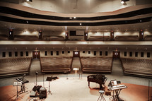 Auditorium with a stage and musical instruments.