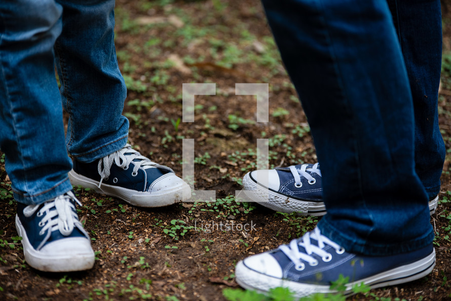father and son in matching sneakers