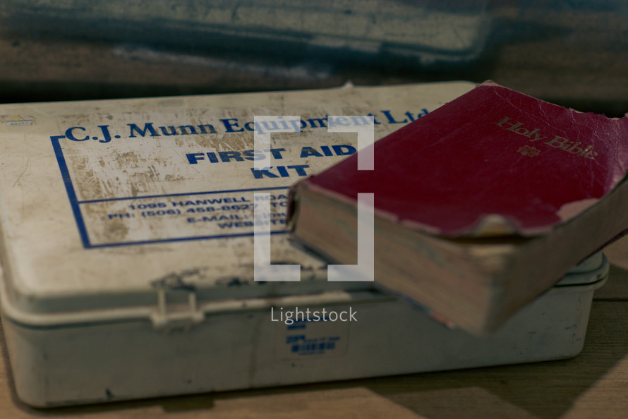 old first aid kit and holy bible photo by tina vanderlaan lightstock