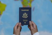 hands holding up a passport