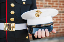 Marine holding his hat