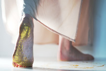 woman with glitter on her feet