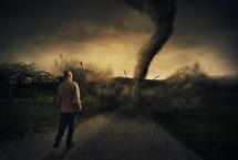 man watching the destruction of a tornado