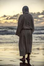 Jesus standing on a beach