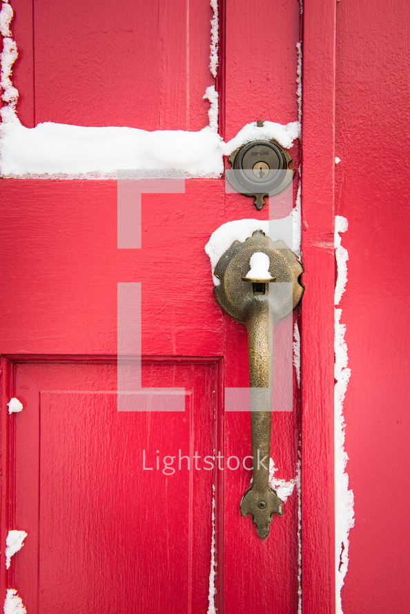 snow on a red door