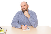 man thinking with a pen notepad