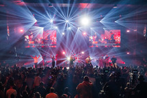 worship leaders on stage singing during a worship service