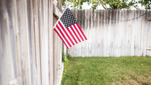 American flag on a fence